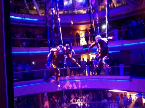 The aerial show hovers at deck seven over the Centrum lobby. The acrobats also dance in the production shows.