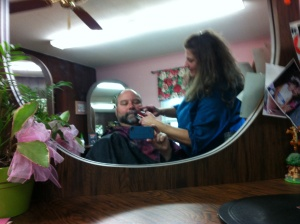 Halfway through the task, Theresa Constantine works on my thick beard.