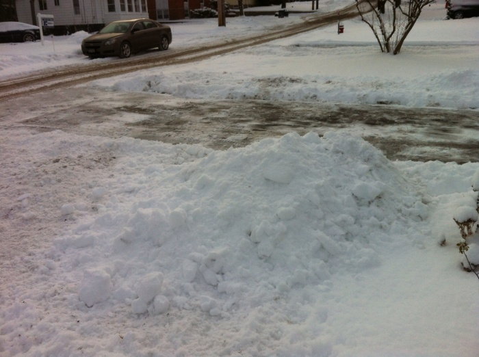 Already, a mound of removed snow is making a mountain where I must throw it.