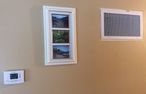 New thermostat, left. New grate, right. Photos from Hawaii, center. Nice wall.