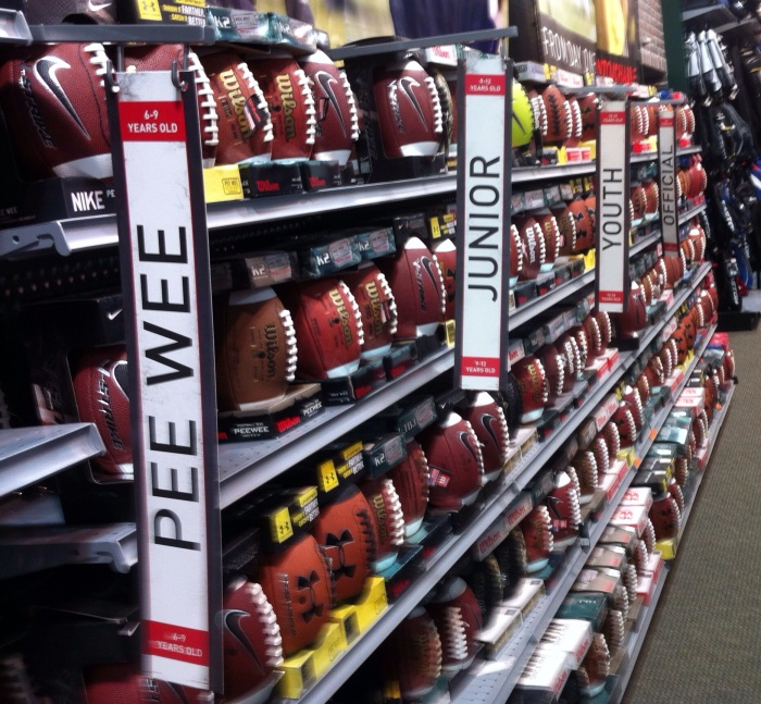 In America, football comes in many shapes and sizes, as shown in this Syracuse, N.Y., Dick's Sporting Goods store.