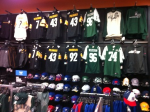 We can buy teams jerseys, team hats, team shirts, and so much NFL stuff, as displayed in this Syracuse, N.Y., The Sports Authority store.