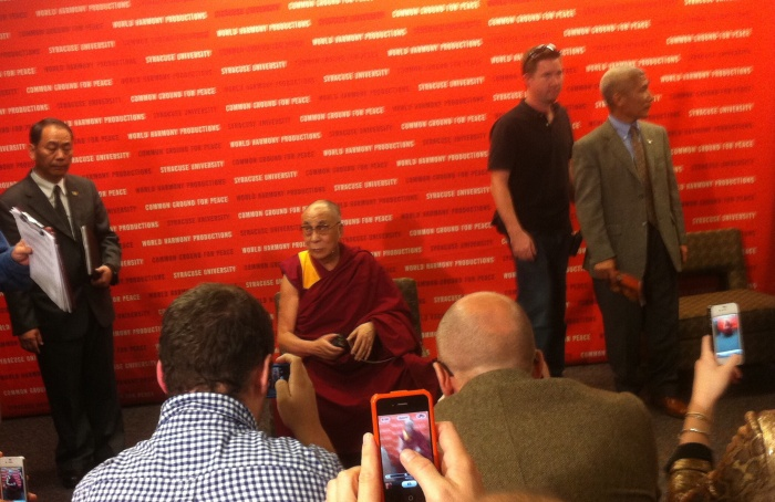 Ready to address the press is the Dali Lama.