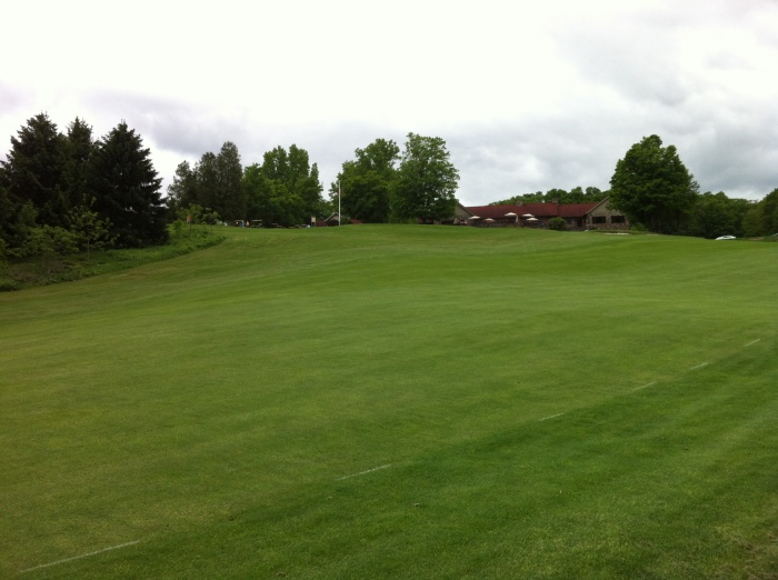The ninth is a par five that winds back up the hill toward the club house restaurant and patio.