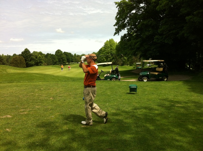 Tater, in balance after hitting his tee shot on the par-three sixth hole.