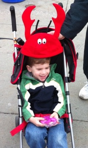 Evan Eggert of Syracuse doesn't really want to wear his Crawfish hat, but mom Julie cooperates for the photo opp.