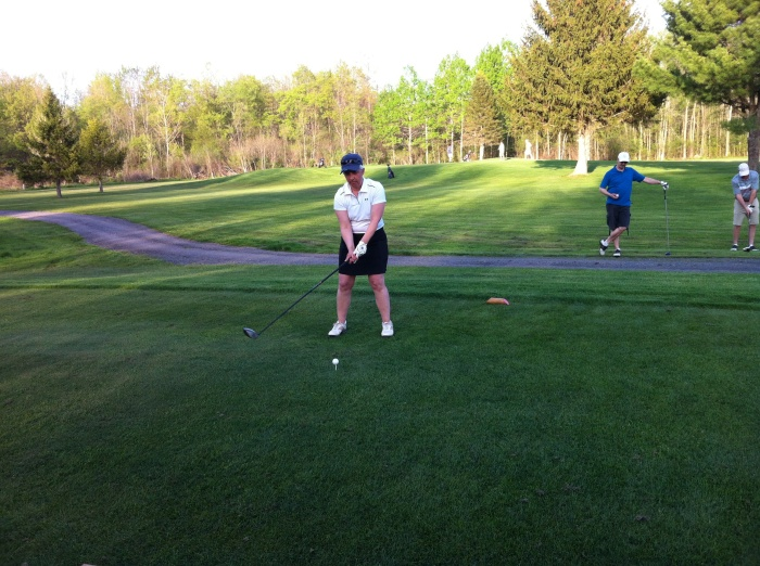 Morelli tees off on No. 16. with Bird and DJ looking on.