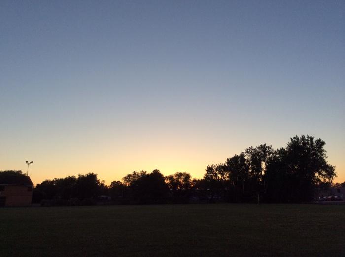 The sun sets on Syracuse, N.Y., on June 21, 2014.