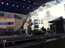 Tim Herron plays on the main stage of Taste of Syracuse, with the National Grid building in the background.
