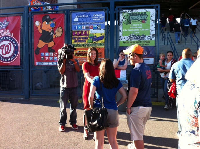 TV crews interview baseball fans before they enter NBT Bank Stadium Friday in Syracuse.