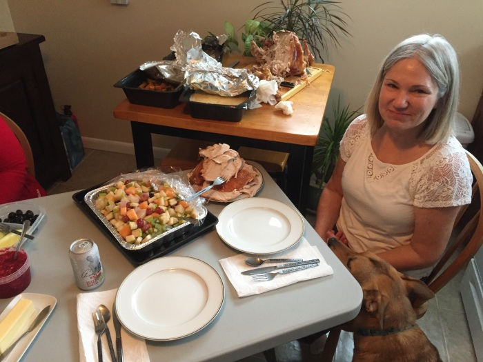 My dear wife Karen, with the turkey that once again succeeded in carving.
