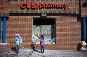 Girls clean up their neighborhood in Baltimore. (Getty Images)