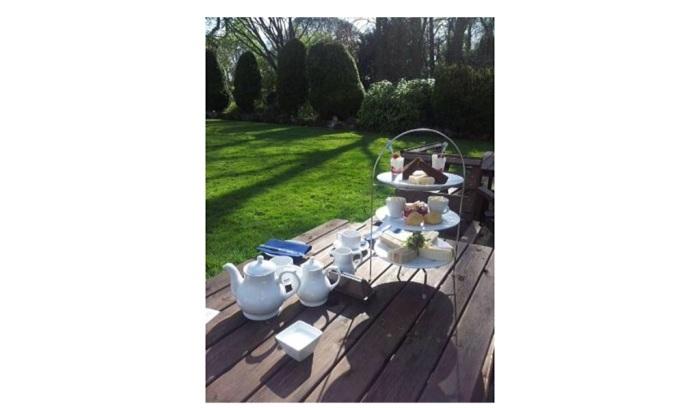 Afternoon Tea on the Lawn (http://media-cdn.tripadvisor.com/media/photo-s/02/74/d2/8a/filename-afternoon-tea.jpg )