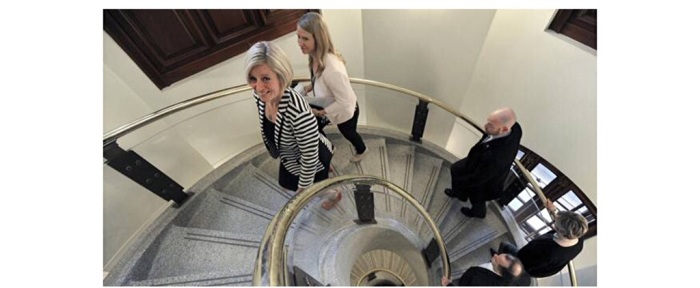 Alberta New Democratic Party leader Rachel Notley, left, and her staff enter the Alberta Legislature Building via a spiral staircase for the first time as premier-elect in Edmonton on May 6, 2015.