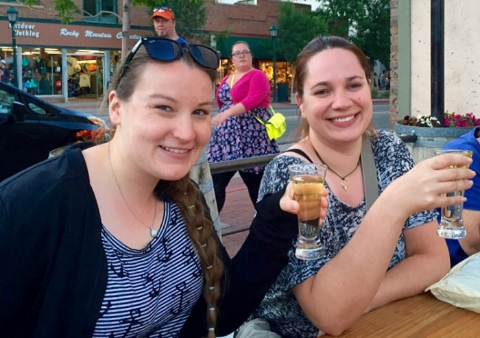 Elisabeth and Dacia toast with a pineapple sampler.