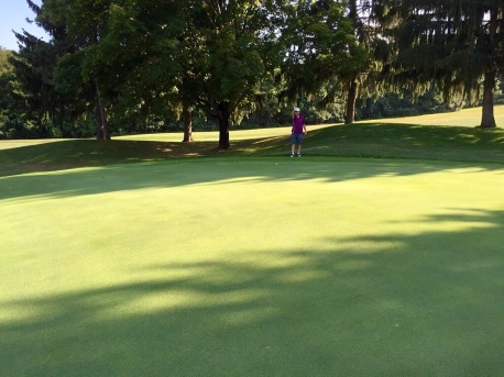 I try to figure out the long putt's break.