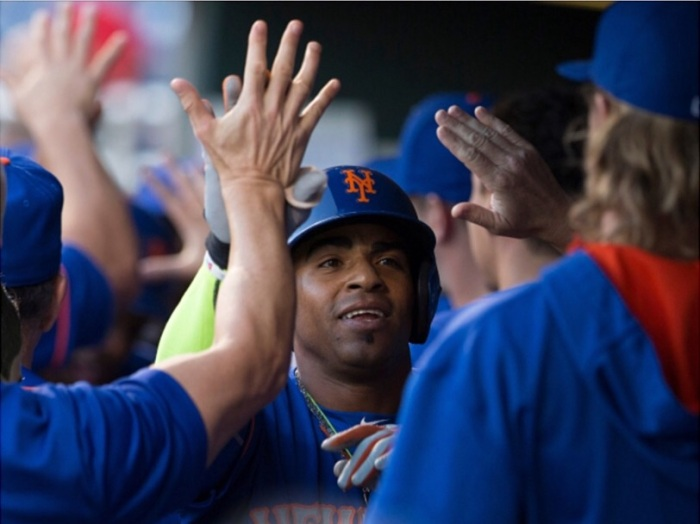 High fives for the new Met Cespedes.  (Photo from Getty Images)