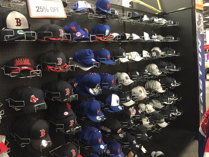 Mets' blue-and-orange amid the Red Sox and Yankees hats at The Sports Authority.