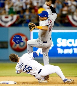 Chase Utley collides with Ruben Tejada in the seventh inning Saturday night. (Getty Images)