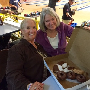 Good friend Diane Monthie celebrates with Karen at bowling night.