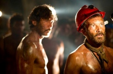 Lou Diamond Phillips, left, and Antonio Banderas play miners considering their fate in The 33.  (From IMDb.com)