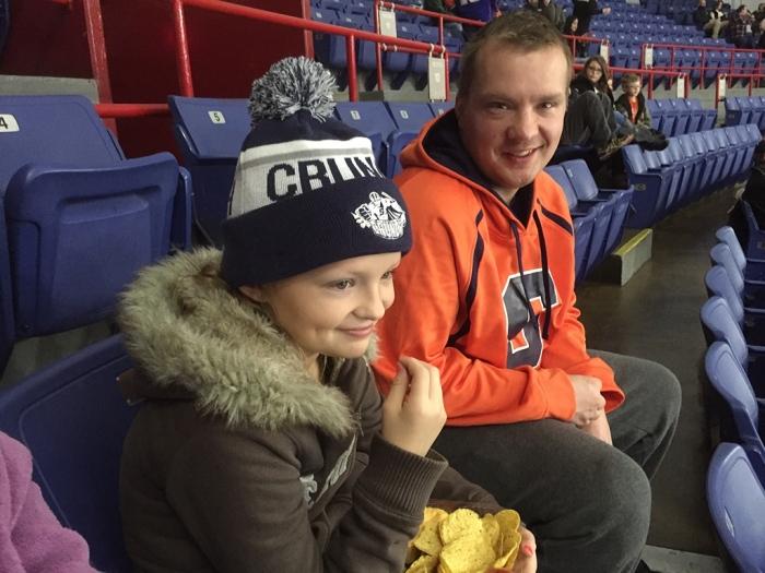 Brianna and Randy ready for hockey.