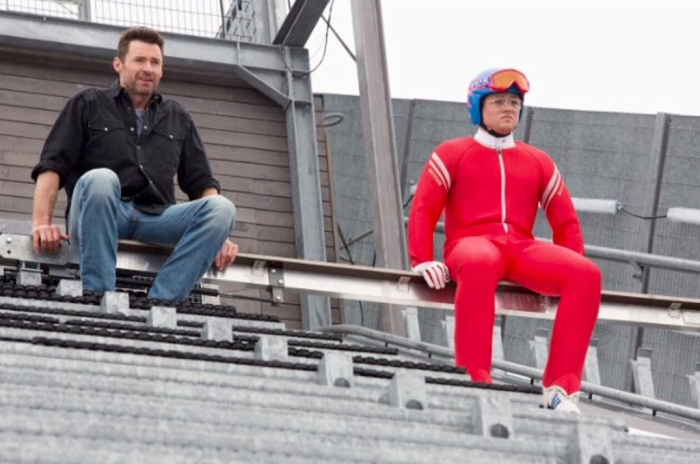 Hugh Jackman and Taron Egerton as reluctant teacher and persistent student in Eddie the Eagle. (From IMDb.com)