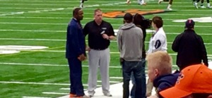 New Syracuse football coach Dino Babers gets interviewed before Saturday's spring game.