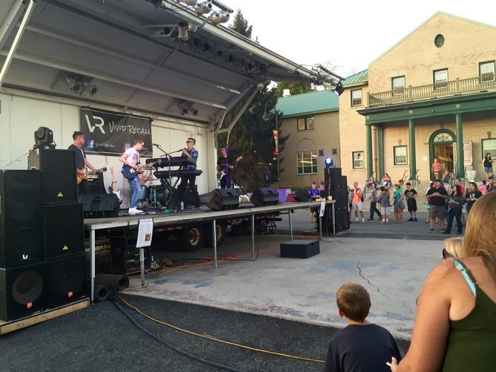 The young band at a small stage.
