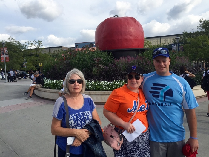 Karen, Elisabeth and George with the outside Apple.