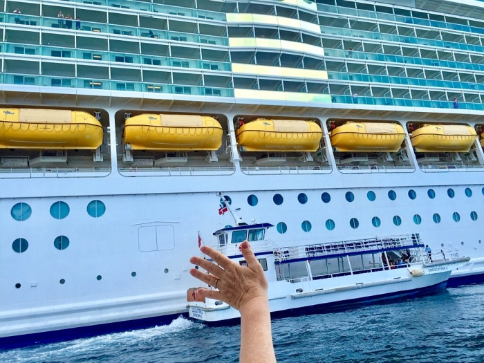 Karen gives an impromptu wave of jubilation toward our ship.
