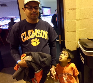 Dad and kid Clemson followers.